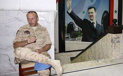 UN observer in Syria. Led by the nose? (photo credit: AP Photo/Muzaffar Salman)