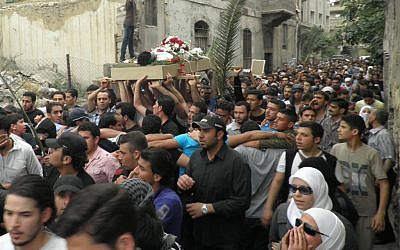 The funeral of a man killed in Damascus on Sunday (photo credit: AP)