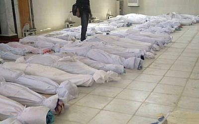 Dead bodies following the assault on Houla, Syria, in May (photo credit: AP/Shaam News Network. AP cannot independently verify this photo)