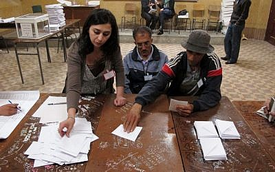 Algerians vote in Algiers Thursday (photo credit: AP Photo/Paul Schemm)