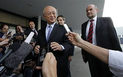 Director General of the International Atomic Energy Agency, IAEA, Yukiya Amano prior to his departure to Iran from Vienna on Sunday, May 20, 2012. (AP Photo/Ronald Zak)