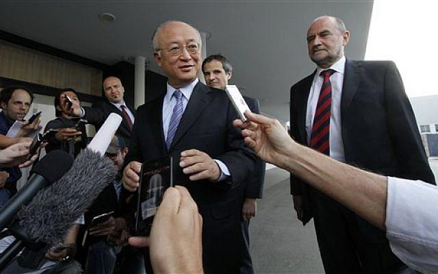 Director General of the International Atomic Energy Agency, IAEA, Yukiya Amano prior to his departure to Iran from Vienna on Sunday, May 20, 2012. (AP Photo/Ronald Zak)