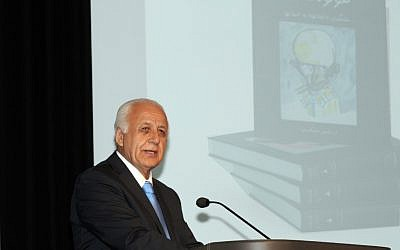 Ari Babaknia speaks at the book launch, held at the Museum of Tolerance in Los Angeles, for his four-volume Farsi-language book on the Holocaust. (photo credit: Ari Babaknia/JTA)