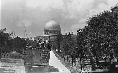 Col. Gur's halftrack, after breaking through Lion's Gate, on Temple Mount heading for the Dome of the Rock (photo credit: Bamahane)