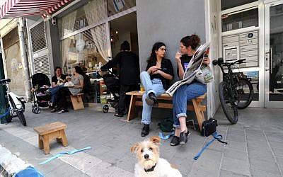 Customers eat outside and indoors at the Devotchka Sandwich Bar just south of the Levinsky Spice Market (photo credit: David Katz)