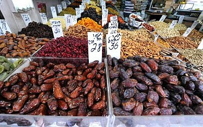 Dried fruits and nuts at the Levinsky spice market (photo credit: David Katz)
