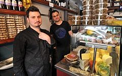 Eitan and Yomi Yom Tov of the Yom Tov Delicatessen in the Levinsky Spice Market in Tel Aviv (photo credit: David Katz)