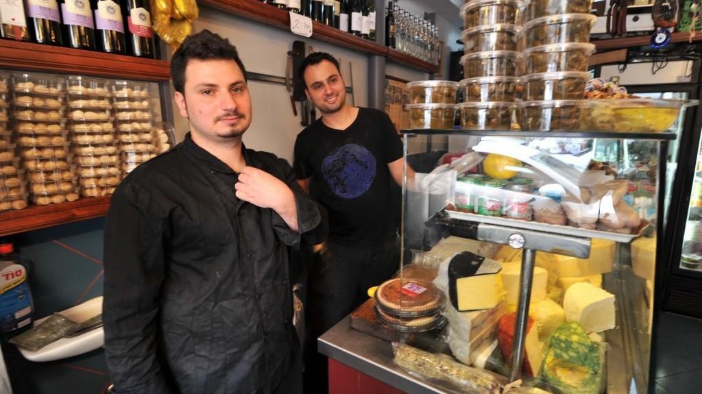Eitan and Yomi Levi of the Yom Tov Delicatessen in the Levinsky Spice Market in Tel Aviv (photo credit: David Katz)