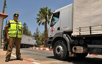 Red Cross trucks carrying the bodies of Palestinian terrorists as part of a 2008 exchange (photo credit:by Hamad Almakt/Flash90)