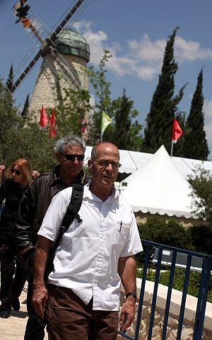 Writer Meir Shalev entering the festival, with the iconic Mishkenot Sha'ananim windmill behind him (photo credit: Yossi Zamir/Flash 90)
