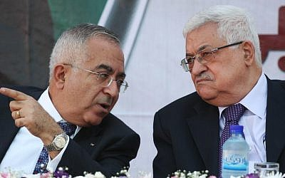 Former Palestinian Authority Prime Minister Salam Fayyad (left) with Palestinian Authority President Mahmoud Abbas (photo credit: Issam Rimawi/Flash90)