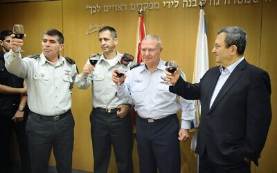 Former IDF chief of General Staff Gabi Ashkenazi (first from left), former Military Intelligence chief Amos Yadlin (second from right) and Defense Minister Ehud Barak at a ceremony in 2010. (photo credit: IDF Spokesman's Office/Flash90)