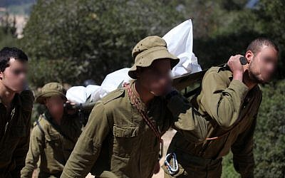 .Soldiers carrying the body of a soldier who committed suicide at a stalactite cave near Beit Shemesh in March 2011 (Photo credit: Abir Sultan/ Flash 90)