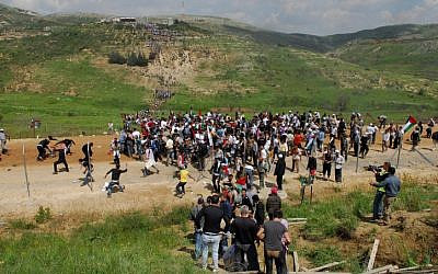 Protesters making their way across Israel's border during last year's Nakba Day demonstrations along the Syrian border (Photo credit: Hamad Almakt/ Flash 90)