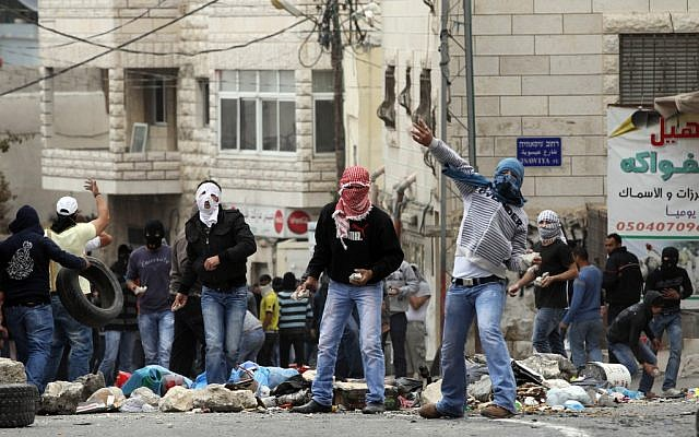 Stone-throwing Palestinians in East Jerusalem  (illustrative photo credit: Nati Shohat/Flash90)