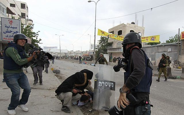 Protests at Qalandiya in 2011. (photo credit: Nati Shohat/Flash90)
