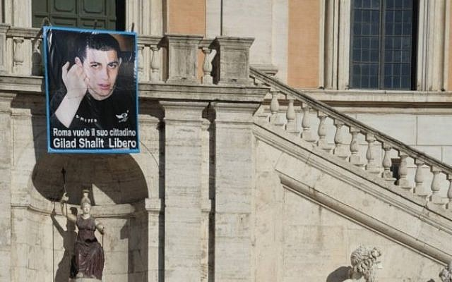 A picture of Gilad Shalit hung on Rome's city hall during the soldier's captivity. (photo credit: Amos Ben Gershom/GPO)