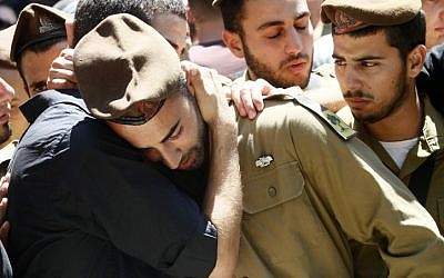 Israeli soldiers mourning the death of 22-year-old soldier Moshe Naftali in August, 2011. (photo credit: Uri Lenz/ Flash90)