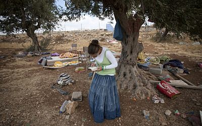A Settler prays following a demolition of a house at the illegal outpost of Ramat Migron in August 2011 (photo credit: Yonatan Sindel/Flash90)
