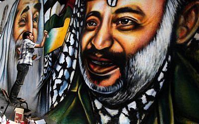A mural of Arafat in Gaza (photo credit: Wissam Nassar/Flash90)