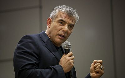 Yair Lapid, the founder of Yesh Atid, will rally Friday to protest Wednesday's breakdown in talks over universal conscription (photo credit: Yonatan Sindel/Flash 90)