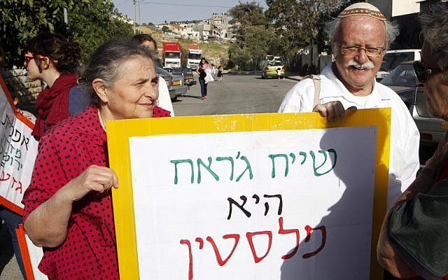 Left-wing activists protest against Jewish settlement in Jerusalem's predominantly Arab neighborhood of Sheikh Jarrah in April. (photo credit: Sliman Khader/Flash90)