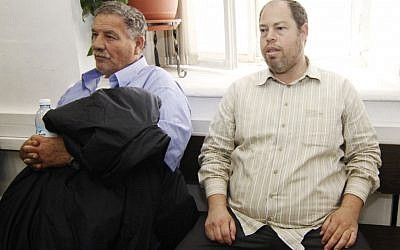 Itzik Tzuker (left) and Oren Varshebski in the Jerusalem's Magistrates Court on April 23, 2012 (photo credit: Alex Sela/Flash90)