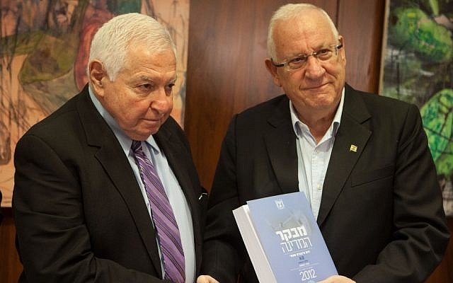 State Comptroller Micha Lindenstrauss hands his annual report to Speaker of the Knesset Reuven Rivlin in Jerusalem on Tuesday. (photo credit: Uri Lenz/Flash90)