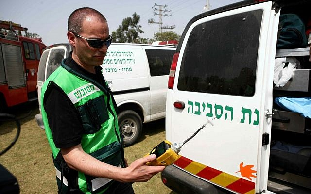 An Environmental Protection Ministry worker checking the air in central Israel Thursday. (photo credit: Yehoshua Yosef/Flash90)