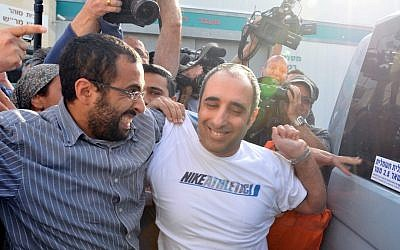 Hagai Amir, right, is surrounded by ebullient family members and reporters as he leaves Ayalon Prison on Friday morning (photo credit: Yossi Zeliger/Flash90)