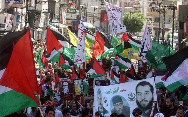 Hamas supporters hold a rally in the West Bank city of Ramallah, calling for the release of Palestinians being held in Israeli prisons on Friday (photo credit: Issam Rimawi/Flash 90)