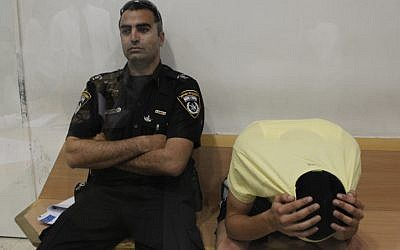 Eden Ohayon, the then-18-year-old suspect in the murder of Gadi Vichman in a court hearing in Beersheba in 2012. (photo credit: Tsafrir Abayov/Flash90)