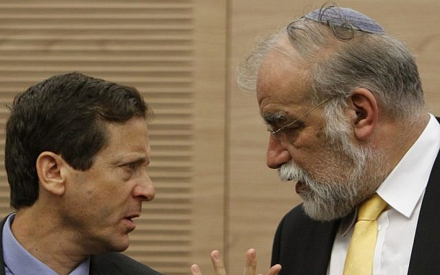 David Rotem (right) speaks to Isaac Herzog at the Knesset on Monday morning (photo credit: Miriam Alster/Flash90)