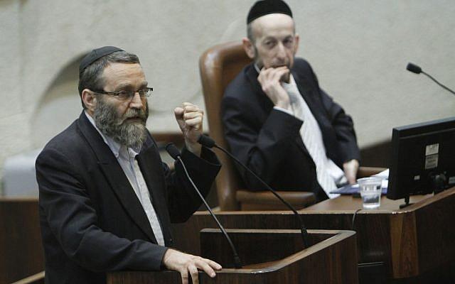 MK Moshe Gafni (left) addressing the Knesset. (photo credit: Miriam Alster/Flash90)