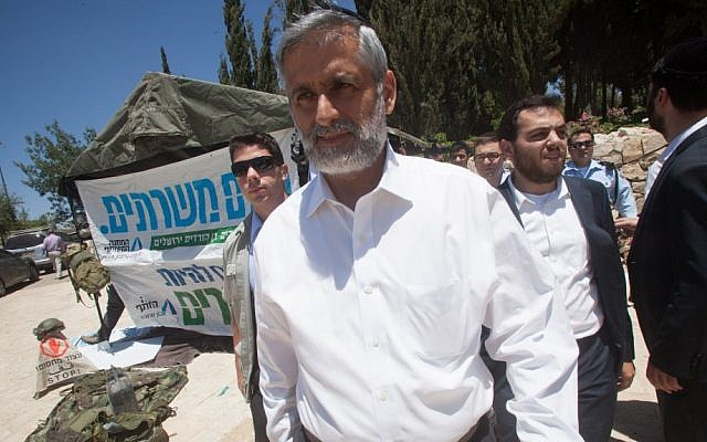 Eli Yishai visits protesters calling for an equal distribution of national service last month (photo credit: Uri Lenz/Flash90)