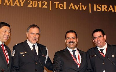 L to R: Interpol's president Khoo Boon Hui, Israeli police chief Yochanan Danino, Noble Secretary General of Interpol Ronald Kenneth, and Yoav Segalovitz, head of Police Intelligence, at the Interpol Conference in Tel Aviv earlier this month (Photo credit: Gideon Markowicz/Flash90
