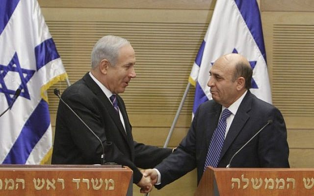 Prime minister Benjamin Netanyahu and  Kadima chairman Shaul Mofaz, hold a joint press conference announcing a new unity government, on Tuesday (photo credit: Miriam Alster/Flash90)