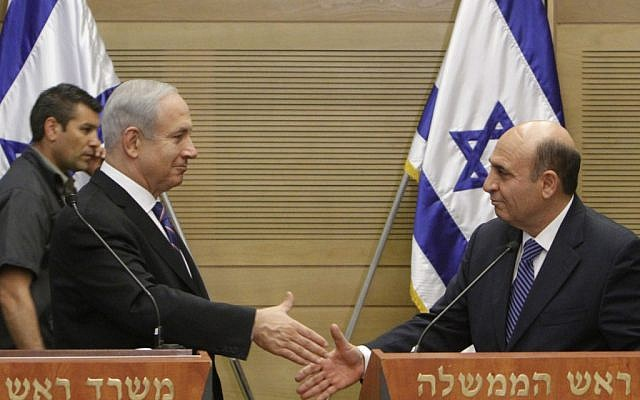 Prime Minister Benjamin Netanyahu and Shaul Mofaz at their joint press conference Tuesday (photo credit: Miriam Alster/Flash90)