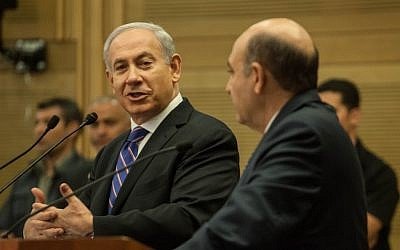 Bibi and Shaul Mofaz explaining their decision to create a unity government (photo credit: Uri Lenz/Flash90)