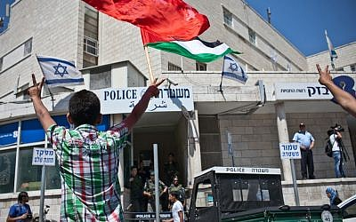 Palestinian relatives and family members demonstrate in front of the police station in Sheikh Jarrach in Jerusalem on Friday. (photo credit: Noam Moskowitz/Flash90)