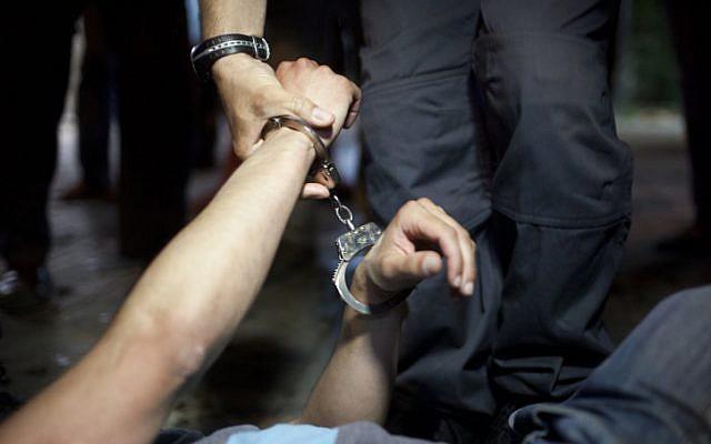 Illustrative photo of a man being arrested (Matanya Tausig/Flash90)