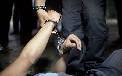 Illustrative photo of a police arrest (Matanya Tausig/Flash90)