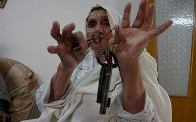 An elderly woman in the West Bank city of Ramallah displaying the keys to a previous home, before the Israeli victory in 1948. (Photo credit: Issam Rimawi/ Flash 90)