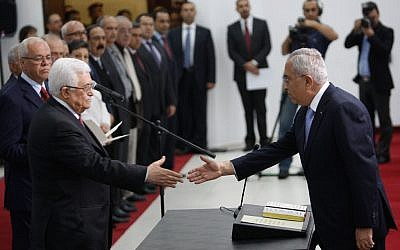 Palestinian Authority President Mahmoud Abbas swears in his new cabinet (photo credit: Issam Rimawi/Flash90)