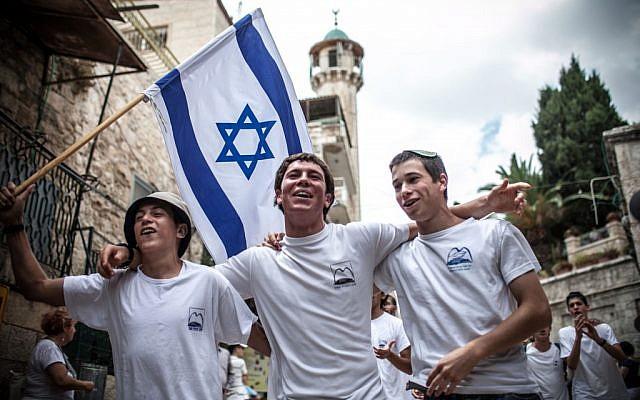 Yeshiva students celebrate Jerusalem Day by marching through Jerusalem's Old City on Sunday (photo credit: Noam Moskowitz/Flash90)
