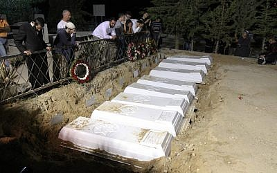 Eight members of the Attias family, killed in a car crash, buried side by side (photo credit: Hamad Almakt/Flash90)
