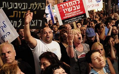 South Tel Aviv residents protest the influx of migrants in their neighborhoods in May 2012. (photo credit: Tomer Neuberg/Flash90)