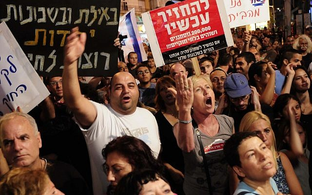 South Tel Aviv residents protest the presence of illegal immigrants in May. (photo credit: Tomer Neuberg/Flash90)
