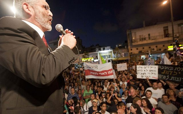 National Union MK Michael Ben Ari speaks before protesters at an anti-migrant rally in Tel Aviv, on Wednesday (photo credit: Tali Mayer/Flash90 )