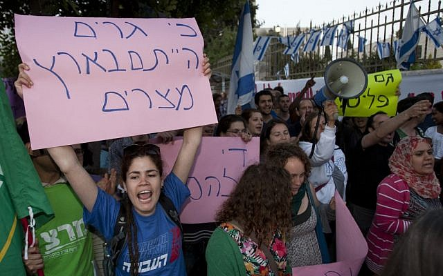 Demonstrators in Jerusalem protest racist incitement and violence against African migrants in Israel on Thursday (photo credit: Yonatan Sindel/Flash90)